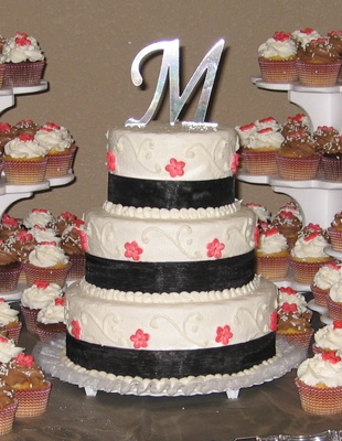 Swooping Scroll with Black Ribbon & Red Sugar Blossoms
